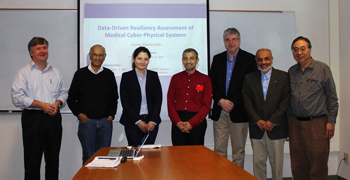 After Homa's successful Ph.D. defense: L-R, Prof. Kalbarczyk, Prof. Iyer, Homa, Dr. Raman, Prof. Sanders, Prof. Patel, Prof. Sha